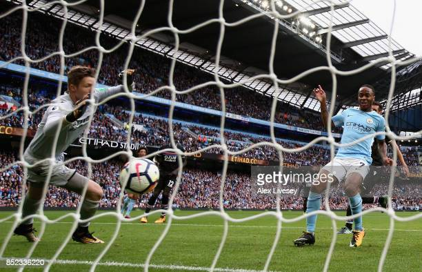 Raheem Sterling of Manchester City scores his sides third goal past Wayne Hennessey of Crystal Palace during the Premier League match between...
