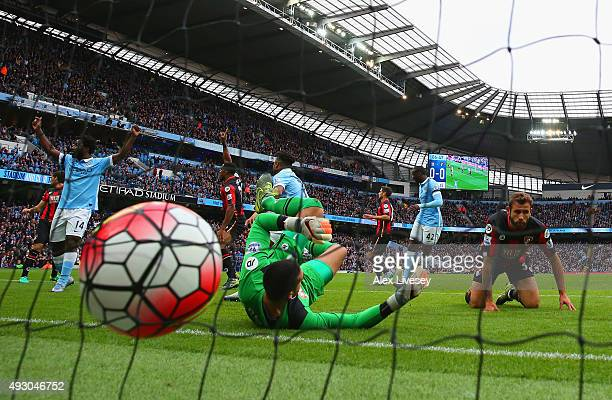 Raheem Sterling of Manchester City scores his team's first goal past Adam Federici of Bournemouth during the Barclays Premier League match between...