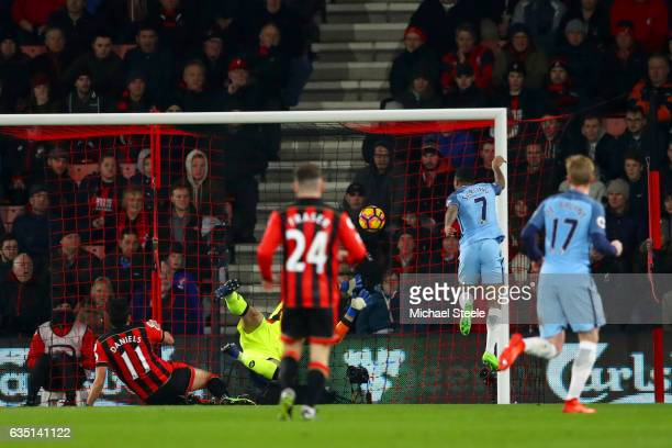 Raheem Sterling of Manchester City scores the opening goal past Artur Boruc of Bournemouth during the Premier League match between AFC Bournemouth...
