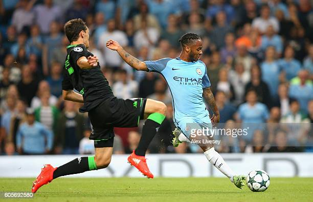Raheem Sterling of Manchester City shoots past Andreas Christensen of Borussia Moenchengladbach during the UEFA Champions League match between...
