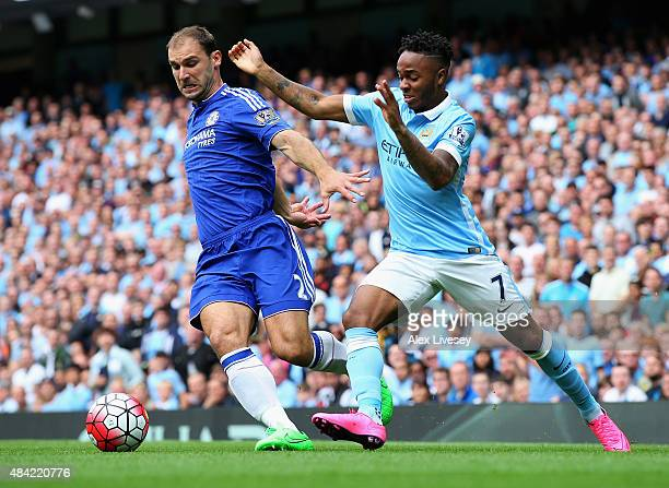 Raheem Sterling of Manchester City takes on Branislav Ivanovic of Chelsea during the Barclays Premier League match between Manchester City and...