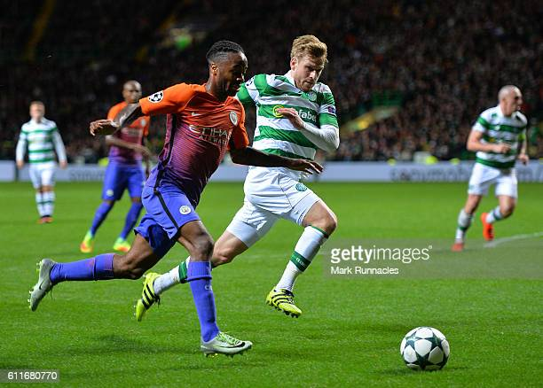 Raheem Sterling of Manchester City takes on Stuart Armstrong of Celtic during the UEFA Champions League match between Celtic FC and Manchester City...