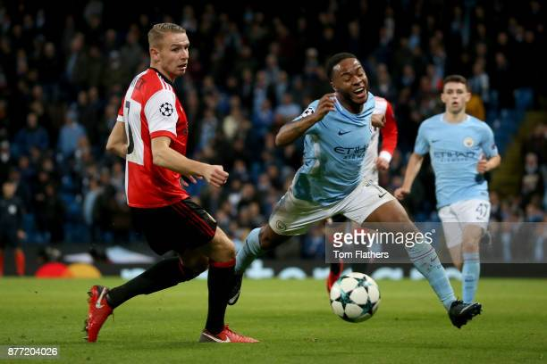 Raheem Sterling of Manchester City takes on Sven van Beek of Feyenoord during the UEFA Champions League group F match between Manchester City and...