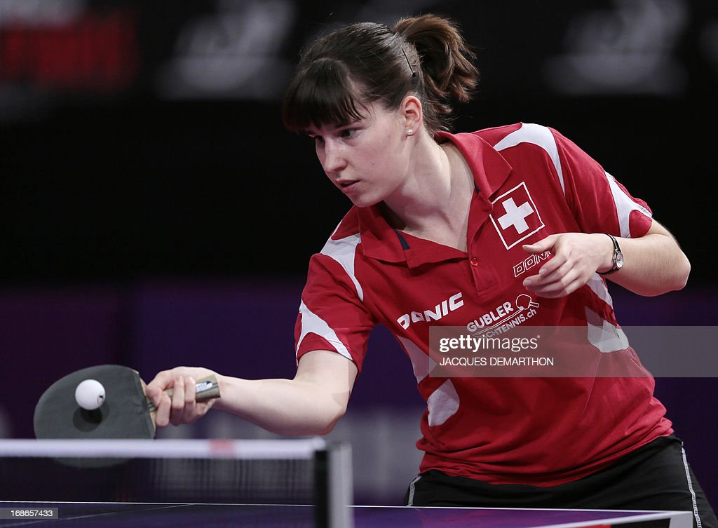 Rahel Aschwanden of Switzerland returns the ball to Ivana Dalovic of Montenegro on May 13, 2013 in Paris, during their World Table Tennis Championships women's singles qualifications groups match. DEMARTHON