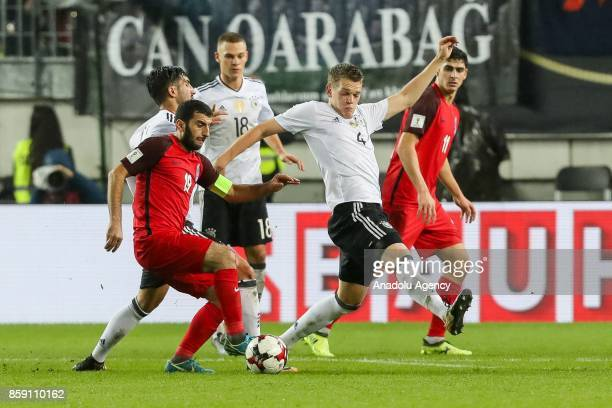 Rahid Amirguliev of Azerbaijan and Matthias Ginter of Germany vie for the ball during the FIFA 2018 World Cup Qualifier between Germany and...