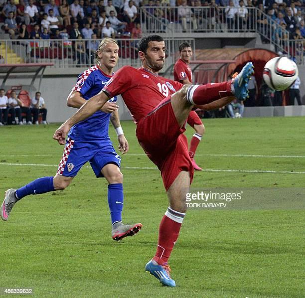 Rahid Amirguliyev of Azerbaijan vies for a ball with Domagoj Vida of Croatia during the UEFA Euro 2016 qualifying football match between Azerbaijan...