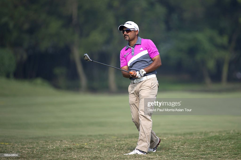 Rahil Gangjee of India hits his 2nd shot on the 18th hole during round three of the Venetian Macau Open on October 19, 2013 at the Macau Golf & Country Club in Macau. The Asian Tour tournament offers a record US$ 800,000 prize money which goes through October 20.