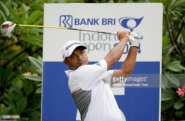 Rahil Gangjee of India plays a shot during practice ahead of the Indonesia Open at Damai Indah Golf Pantai Indah Kapuk Course on December 2 2014 in...