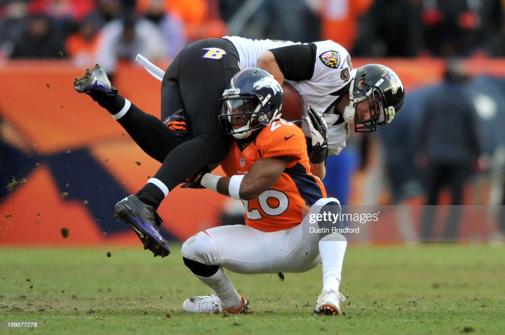 <a gi-track='captionPersonalityLinkClicked' href=/galleries/search?phrase=Rahim+Moore&family=editorial&specificpeople=5510817 ng-click='$event.stopPropagation()'>Rahim Moore</a> #26 of the Denver Broncos tackles <a gi-track='captionPersonalityLinkClicked' href=/galleries/search?phrase=Dennis+Pitta&family=editorial&specificpeople=5516841 ng-click='$event.stopPropagation()'>Dennis Pitta</a> #88 of the Baltimore Ravens during the AFC Divisional Playoff Game at Sports Authority Field at Mile High on January 12, 2013 in Denver, Colorado. The Ravens won 38-35 in 2 overtimes.