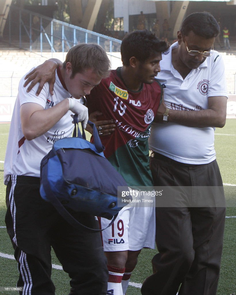 Rahim Nabi (C) of Mohun Bagan is being taken out of the ground after the injury during the derby match of I-League against east Bengal at Yuba Bharati Krirangan, Salt Lake on February 9, 2013 in Kolkata, India.