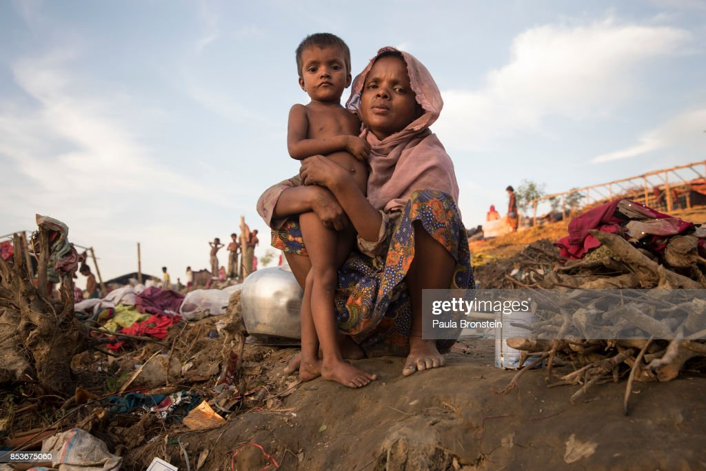 A Rahima Begum,25, holds her daughter Taslima, 4 years old as they wait to be relocated to another camp September 25, 2017 in Thainkhali camp, Cox's Bazar, Bangladesh. Over 429,000 Rohingya refugees have fled into Bangladesh since late August during the outbreak of violence in Rakhine state as Myanmar's de facto leader Aung San Suu Kyi downplayed the crisis during a speech in Myanmar this week faces and defended the security forces while criticism on her handling of the Rohingya crisis grows. Bangladesh's prime minister, Sheikh Hasina, spoke at the United Nations General Assembly last week, focusing on the humanitarian challenges of hosting the minority Muslim group who currently lack food, medical services, and toilets, while new satellite images from Myanmar's Rakhine state continue to show smoke rising from Rohingya villages.