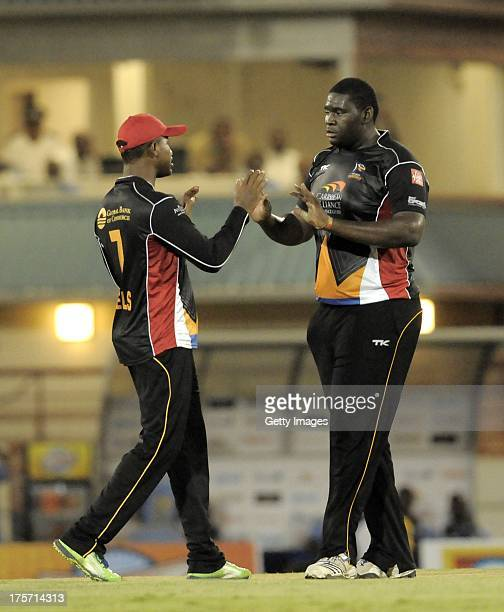 Rahkeem Cornwall gets a highfive from his captain Marlon Samuels of Antigua Hawksbills during the Eighth Match of the Caribbean Premier League...