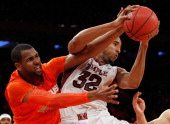Rahlir HollisJefferson of the Temple Owls and James Southerland of the Syracuse Orange scramble for the loose ball during the Gotham Classic at...