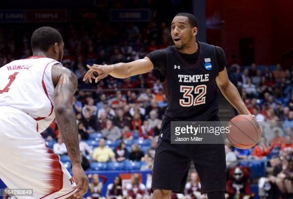 Rahlir HollisJefferson of the Temple Owls handles the ball against Richard Howell of the North Carolina State Wolfpack in the first half during the...