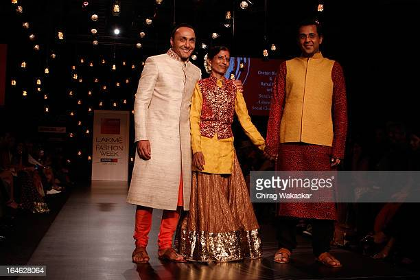 Rahul Bose Ashwini Hobde Chetan Bhagat showcase designs by Vikram Phadnis on the runway during day four of Lakme Fashion Week Summer/Resort 2013 on...