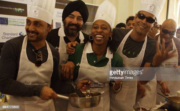Rahul Bose Milind Soman and Gail Devers celebrate Pasta Party at Trident Hotel on Saturday