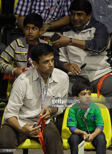 Rahul Dravid and his family enjoy the match between Banga Beats' player Parupalli Kashyap against Delhi Smashers' B Sai Praneeth in the Indian...