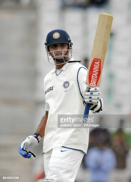 Rahul Dravid celebrates scoring a half century during the first day of the second test at the Punjab Cricket Association Stadium Mohali India