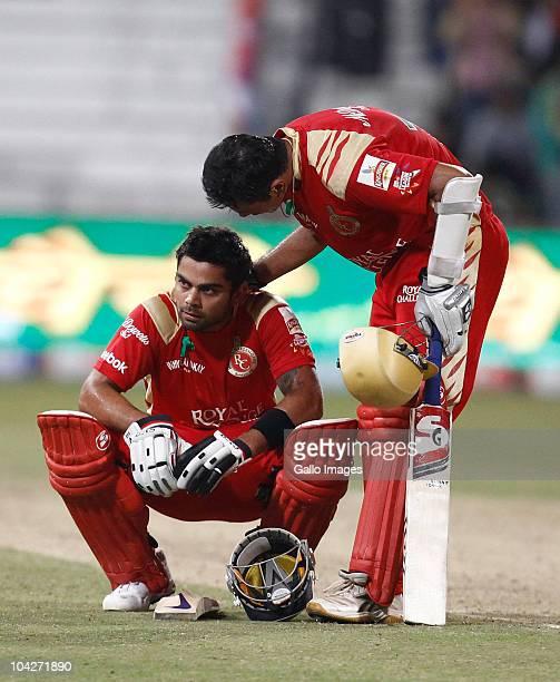 Rahul Dravid consols team mate Virat Kohli of the Royal Challengers Bangalore during the Airtel Champions League Twenty20 match between Mumbai...