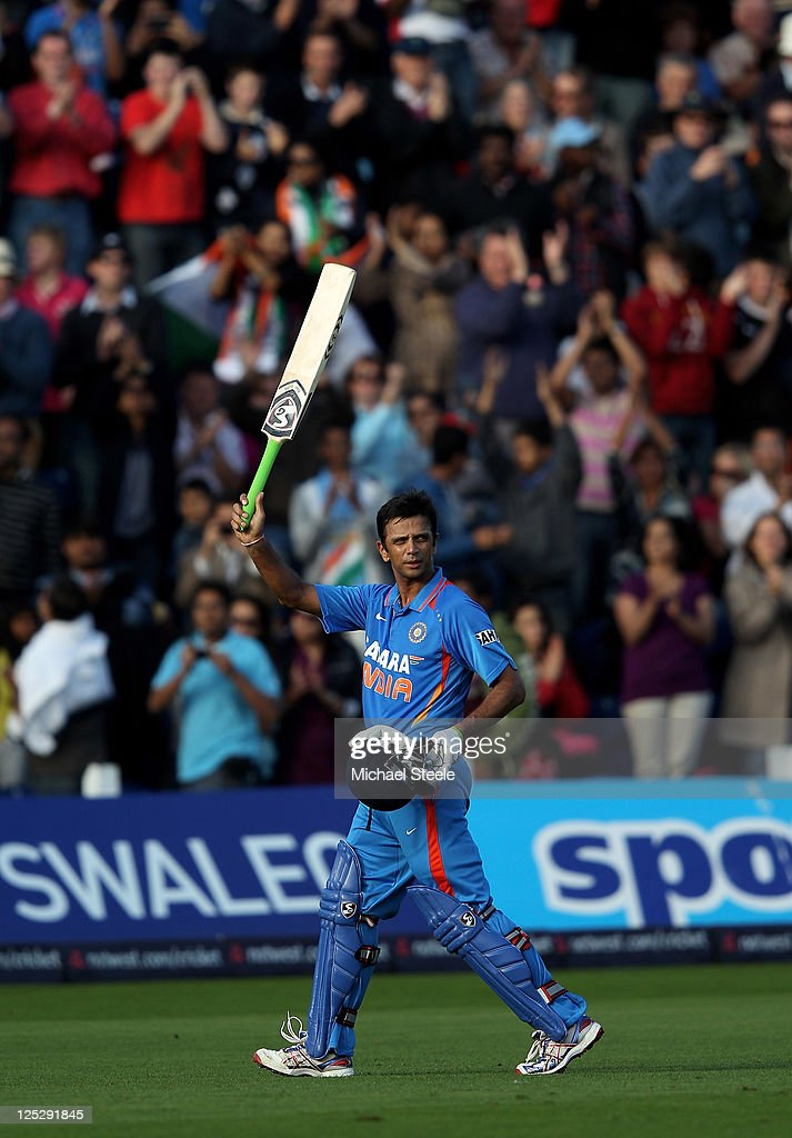 <a gi-track='captionPersonalityLinkClicked' href=/galleries/search?phrase=Rahul+Dravid&family=editorial&specificpeople=211062 ng-click='$event.stopPropagation()'>Rahul Dravid</a> of India acknowledges the crowd as he heads for the pavillion aftre being dismissed in his last ever One Day International match during the 5th Natwest One Day International Series match between England and India at the Swalec Stadium on September 16, 2011 in Cardiff, Wales.