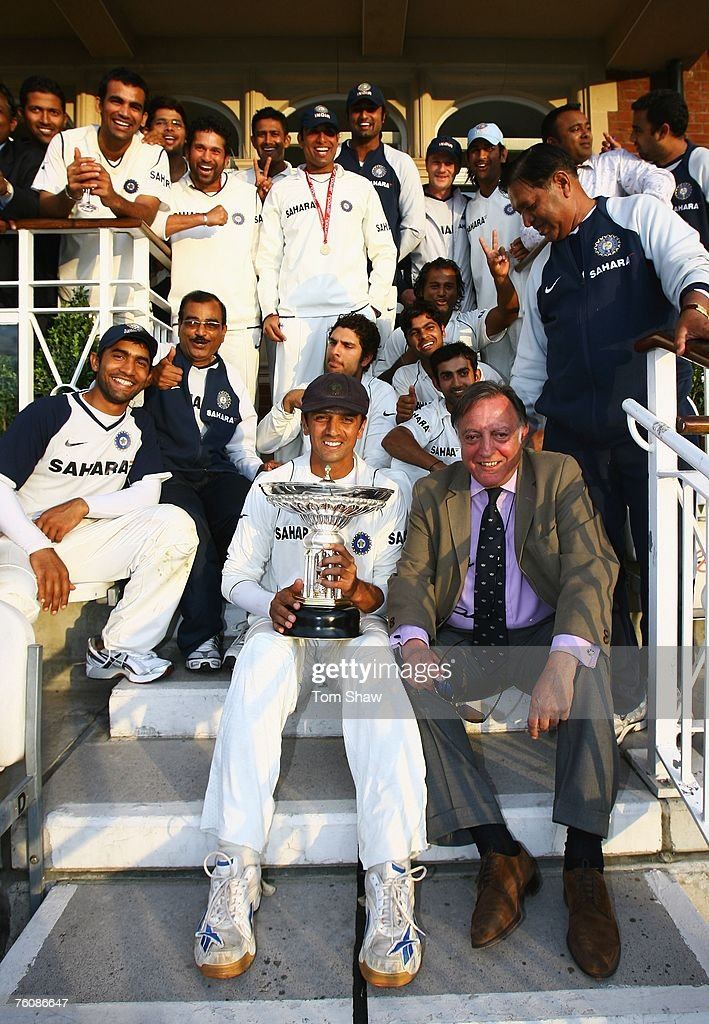 Rahul Dravid of India holds the Pataudi trophy as Indian players celebrate their series win against England with Tiger Pataudi during day five of the Third Test match between England and India at the Oval on August 13, 2007 in London, England.