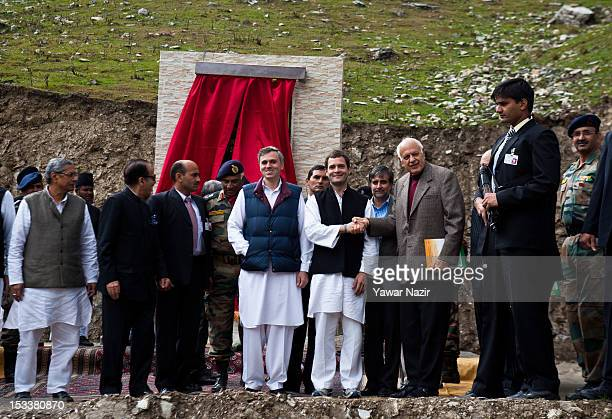 Rahul Gandhi a lawmaker and son of India's ruling Congress party chief Sonia Gandhi shakes hands with Farooq Abdullah former Chief Minister of Jammu...
