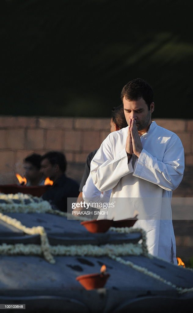 Rahul Gandhi, Congress Party General Secretary and son of Congress Party President Sonia Gandhi (R) prays tribute to his father during a memorial ceremony for slain former Indian prime minister and son Rajiv Gandhi on his 19th death anniversary in New Delhi on May 21, 2010. Rajiv Gandhi was assasinated during electoral campaigning, allegedly by Liberation Tigers of Tamil Eelam (LTTE) rebel separatists, in the town of Sriperumpudur in the southern state of Tamil Nadu on May 21, 1991. AFP PHOTO/ Prakash SINGH