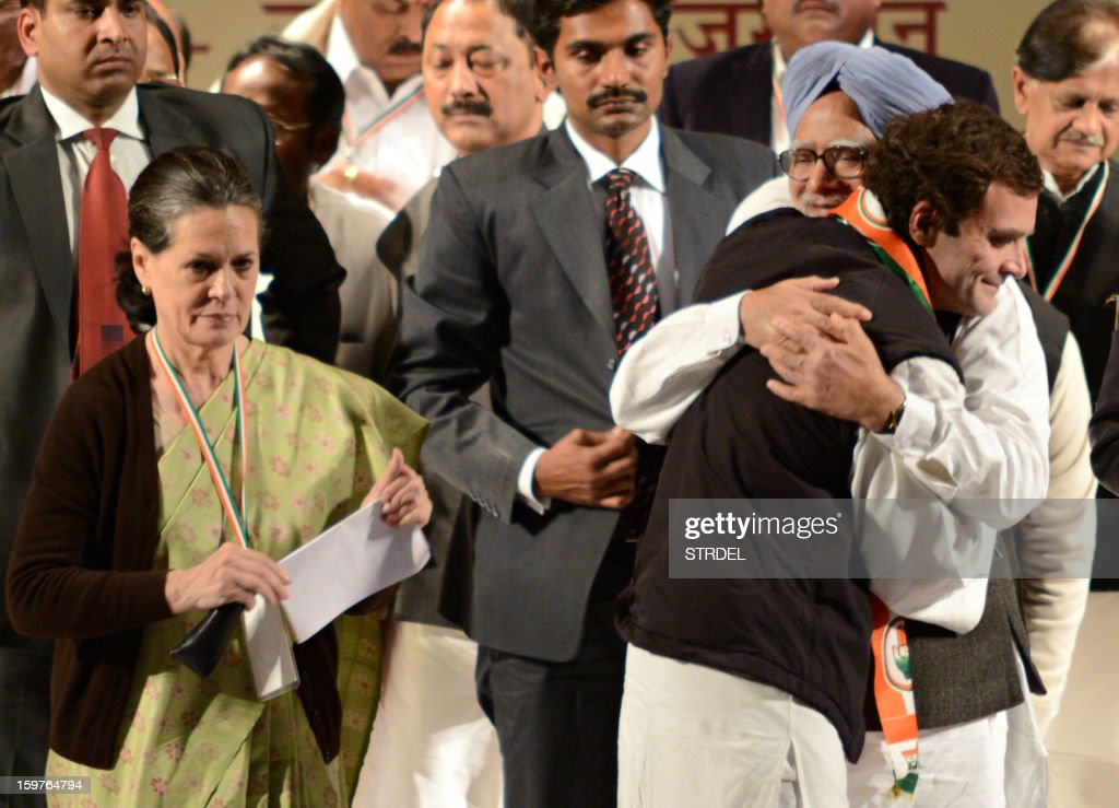 Rahul Gandhi (R) hugs Indian Prime Minister Manmohan Singh before delivering his first speech as Congress party Vice-President while Gandhi's mother and Congress Party President Sonia Gandhi (L) looks on during the Congress party leadership conclave in Jaipur on January 20, 2013. Rahul Gandhi, newly named to the number two post in India's ruling Congress party, delivered a powerful call for change to meet the aspirations of the nation's 'young and impatient' population.