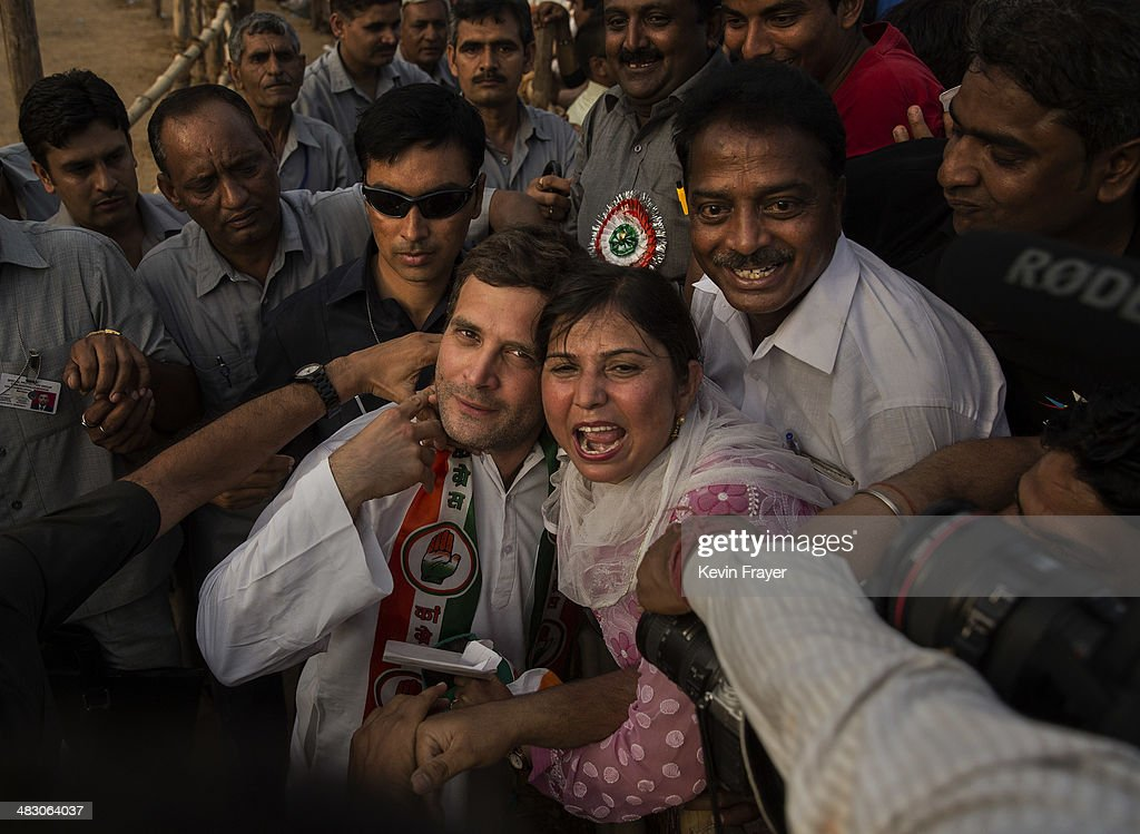 <a gi-track='captionPersonalityLinkClicked' href=/galleries/search?phrase=Rahul+Gandhi&family=editorial&specificpeople=171802 ng-click='$event.stopPropagation()'>Rahul Gandhi</a>, leader of India's ruling Congress Party is embraced by a supporter at a rally on April 6, 2014 in New Delhi, India. India will vote in a nine phase election from April 7-May 12.