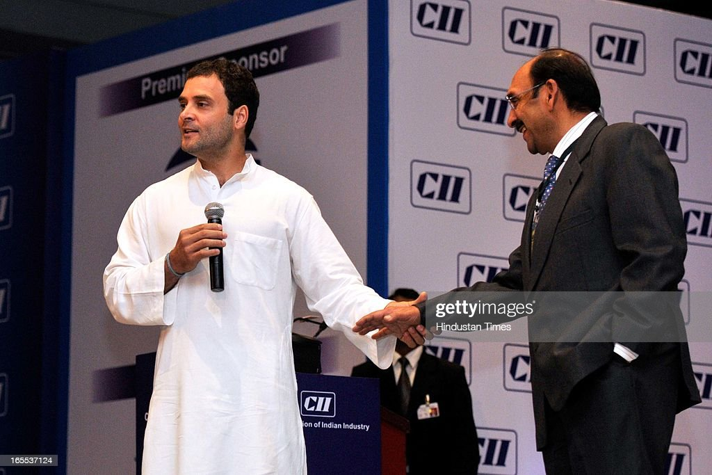 Rahul Gandhi, Vice President Indian National Congress with Ajay Shriram during the formers speech at the special plenary session of CII Annual General Meeting and National Conference 2013 at The Ashoka hotel on April 4, 2013 in New Delhi, India.