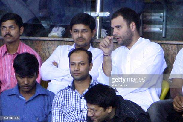 Rahul Gandhi watches India's Suranjoy Mayengbam and Malaysian pugilist Mohd Subriein in action during the 52kg category boxing event of the...