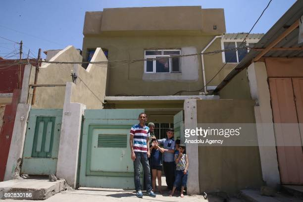 Raid Ahmed and the members of Ahmed family who had fled to Turkey are seen in front of a house of his uncle are seen after returning from Ankara's...