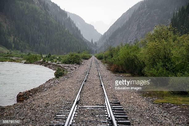 Raid Road tracks towards mountains and Animas River Durango and Silverton Narrow Gauge Railroad Silverton Colorado