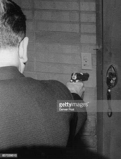 Raider Fires At Locked Door Deputy Investigator John W Stansfield had to fire two shots before heavy lock on lodge door was forced open Credit Denver...