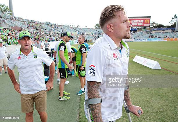 Raiders Coach Ricky Stuart and Blake Austin of Raiders watch as the Raiders celebrate after winning the round one NRL match between the Canberra...