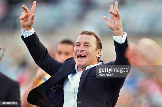Raiders coach Ricky Stuart celebrates a try by his team during the round 11 NRL match between the Canberra Raiders and the North Queensland Cowboys...