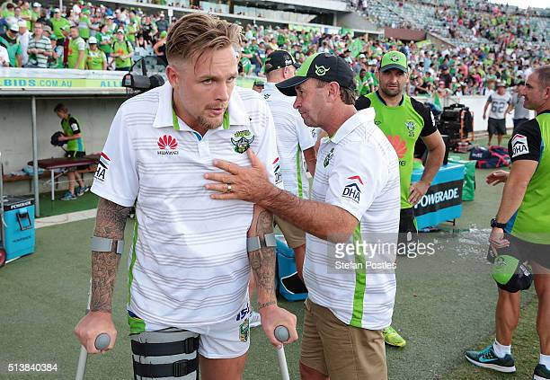 Raiders Coach Ricky Stuart speaks with Blake Austin after winning the round one NRL match between the Canberra Raiders and the Penrith Panthers at...