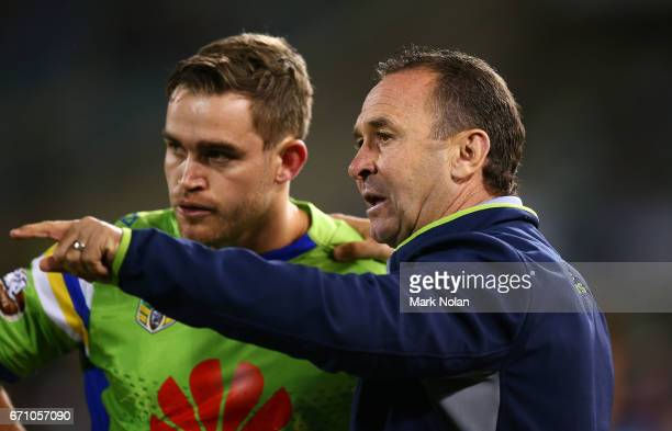 Raiders coach Ricky Stuart talks with Luke Bateman of the Raiders during the round eight NRL match between the Canberra Raiders and the Manly Sea...