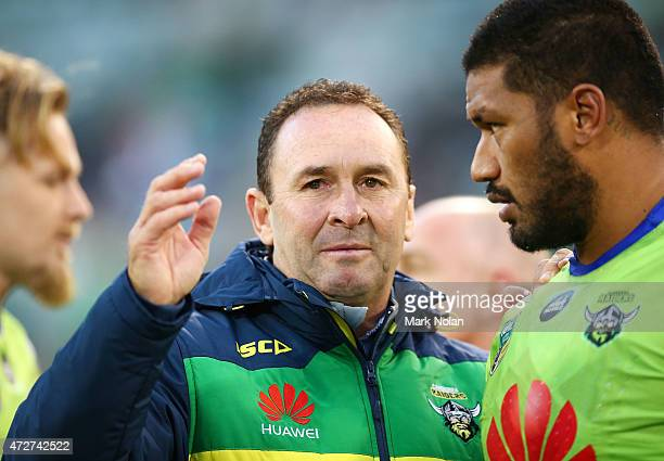Raiders coach Ricky Stuart talks with players during the round nine NRL match between the Canberra Raiders and the GOld Coast Titans at GIO Stadium...