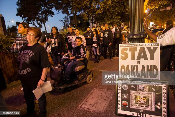 Raiders fan wait in a long line to get into a town hall meeting with NFL executives to voice their concerns against the team possibly moving to Los...