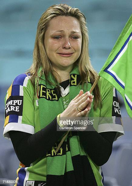Raiders fan weeps after her team was defeated in the NRL Third Qualifying Final between the Bulldogs and the Canberra Raiders at Telstra Stadium...