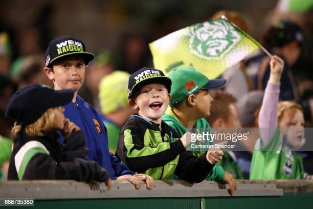 Raiders fans enjoy the atmosphere during the round seven NRL match between the Canberra Raiders and the New Zealand Warriors at GIO Stadium on April...