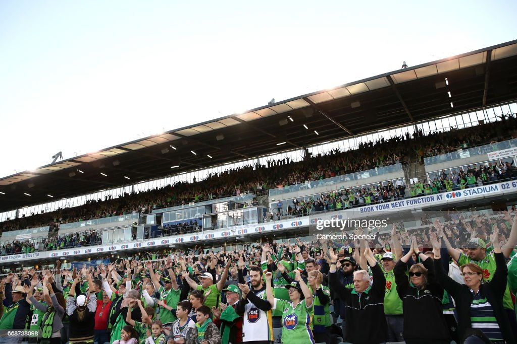 Raiders fans perform the Viking Clap during the round seven NRL match between the Canberra Raiders and the New Zealand Warriors at GIO Stadium on April 15, 2017 in Canberra, Australia.
