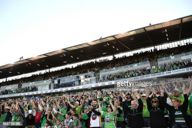 Raiders fans perform the Viking Clap during the round seven NRL match between the Canberra Raiders and the New Zealand Warriors at GIO Stadium on...