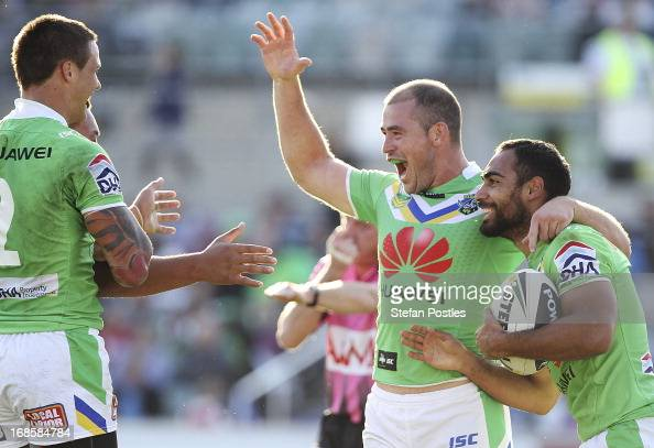 Raiders players celebrate a try by Reece Robinson during the round nine NRL match between the Canberra Raiders and the Newcastle Knights at Canberra...