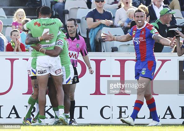 Raiders players celebrate a try by Sandor Earl during the round nine NRL match between the Canberra Raiders and the Newcastle Knights at Canberra...
