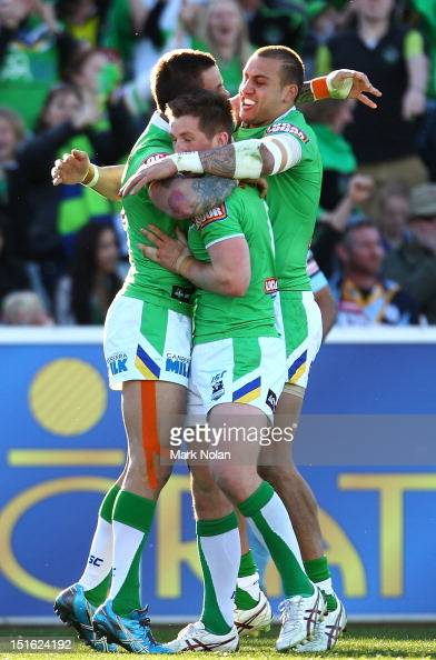 Raiders players celebrate a try by Sandor Earl during the Second NRL Elimination Final match between the Canberra Raiders and the Cronulla Sharks at...