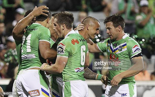 Raiders players celebrate after Sandor Earl scored a try during the round three NRL match between the Canberra Raiders and the St George Illawarra...