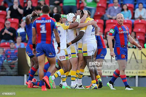Raiders players celebrate after scoring a try during the round 13 NRL match between the Newcastle Knights and Canberra Raiders at Hunter Stadium on...