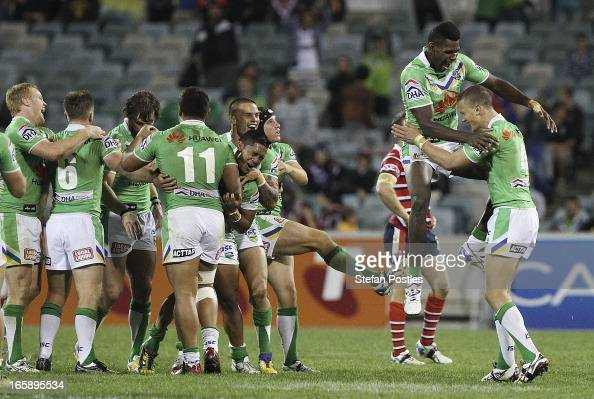 Raiders players celebrate after winning the round five NRL match between the Canberra Raiders and the Sydney Roosters at Canberra Stadium on April 7...